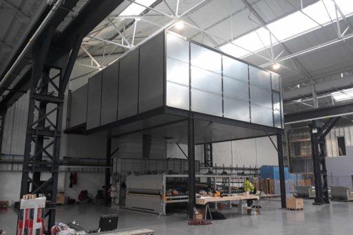 Acoustic enclosure, glass toughening plant